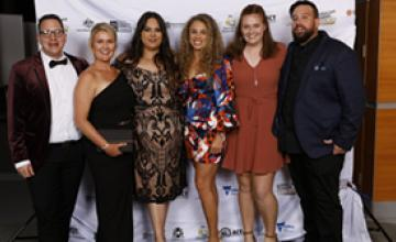 Chloe Baigent centre at the Australian Training Awards